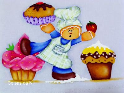 boneco Ginger com mufins e cupcakes