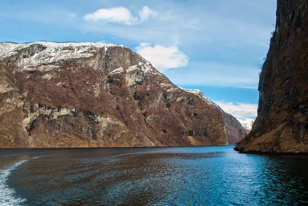 Sailing through the fjords on a fjord cruise in norway