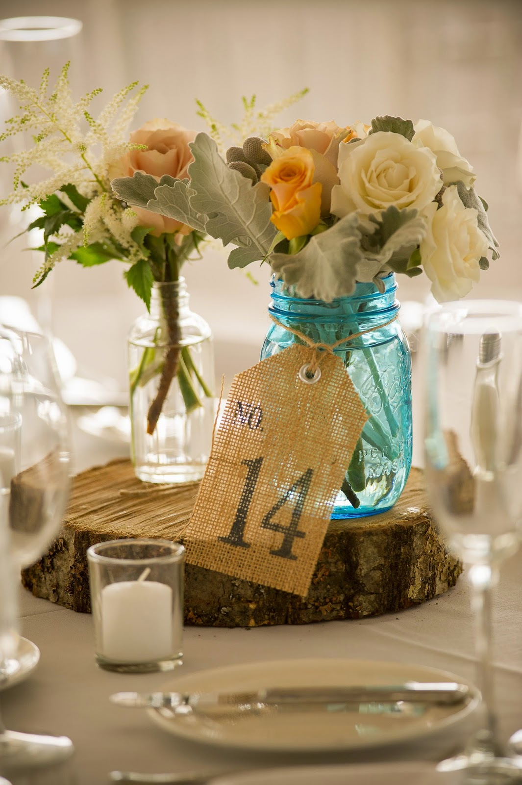 fruit lands museum : fall tent wedding : les fleurs : mkd photography : blue mason jar, white and caramel : tree trunk : wood slab : burlap table numbers