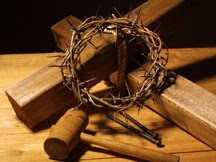 Wooden cross,hammer and crown of thorns with nails at the crucifixion of Jesus Christ