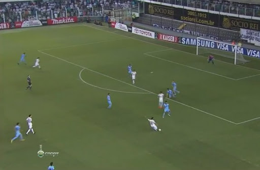 Santos player Elano shoots from long range to score the opening goal against Bolívar