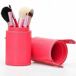 tubo rosa para guardar pinceles de maquillaje