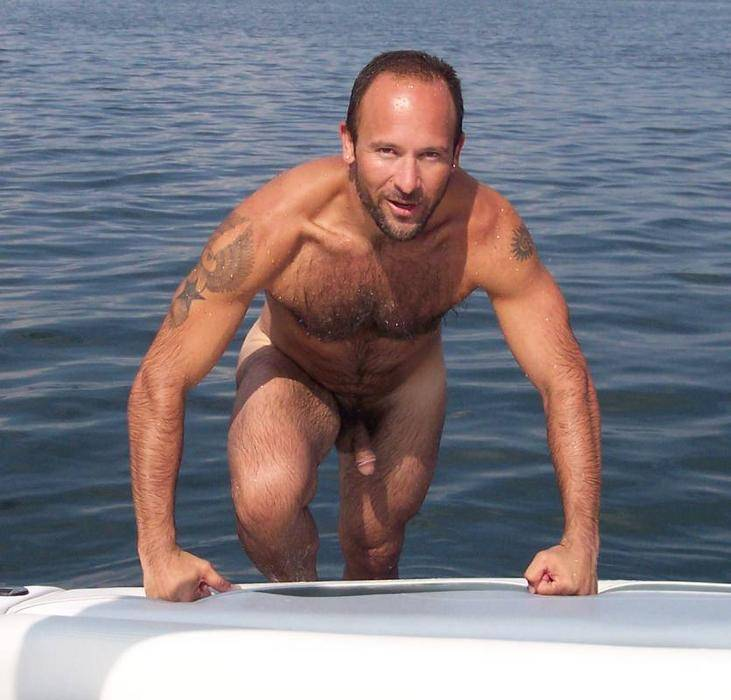 Nude men on a boat