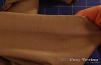 http://www.easysewingforbeginners.com/project/how-to-hem-pants-by-hand/