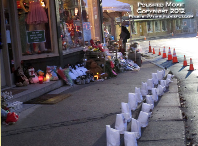 Image of memorial in front of a Sandy Hook shop.