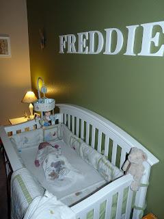 Freddie in his crib