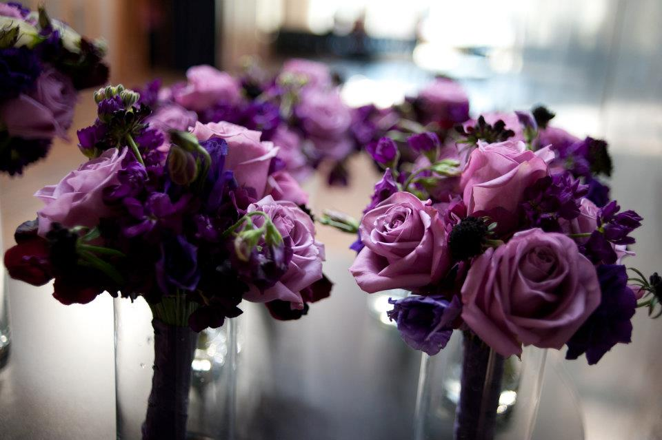 We did petite bouquets for the bridesmaids featuring soft purple roses
