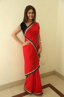 Surabhi Looks Super cute in Red Transparent Saree Gorgeous Smile