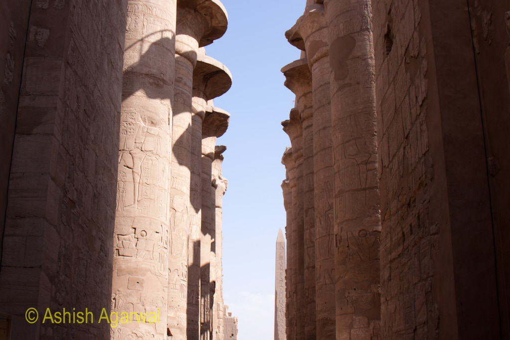 View between the pillars of the Hypostyle Hall inside the Karnak temple in Luxor