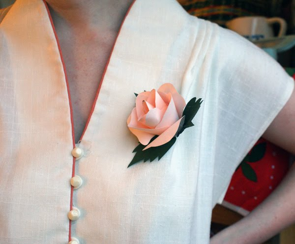 Diy paper flower corsages create a 2 leaf from the green paper glue around the base of the flower glue a brooch pin to the bottom of the flower mightylinksfo