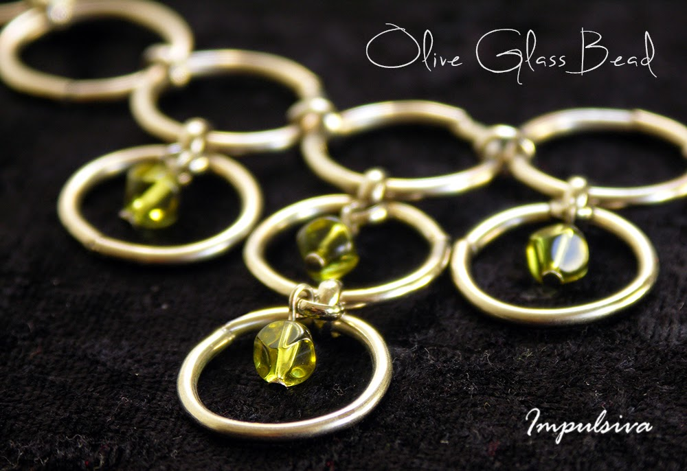 Ring chain necklace with olive crystal glass bead