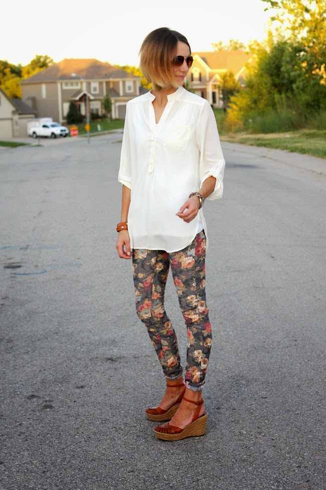 Floral jeans and a cream blouse and wedges