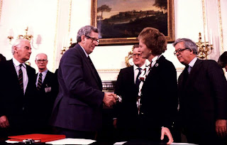 Then Taoiseach Dr. Garrett FitzGerald and British Prime Minister Margaret Thatcher shake hands after signing the Anglo Irish Agreement in Belfast in 1985.
