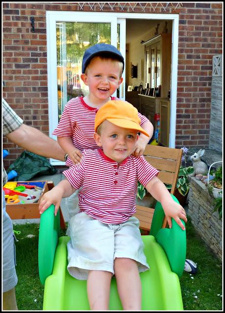 Twin toddler boys slide
