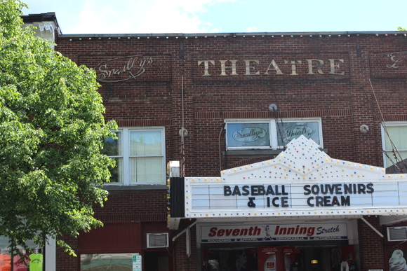 This vintage theatre advertises baseball souvenirs and ice cream.