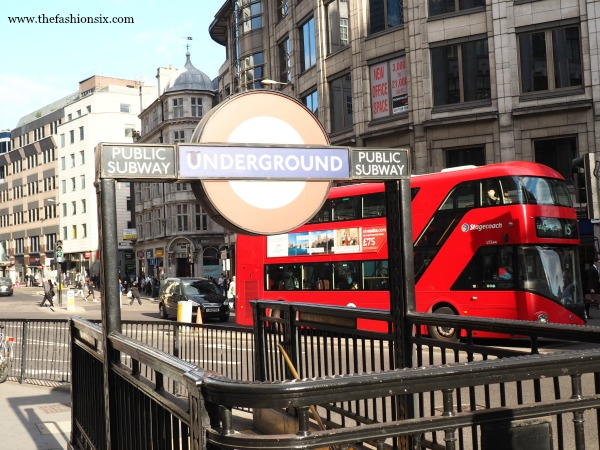 A photo of the London Underground and red bus