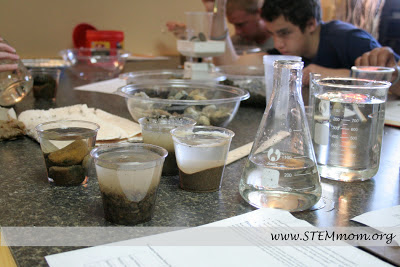Student working on Soil Permeability and Porosity lab: from STEMmom.org