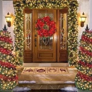 This home's entry is cheerfully decorated to welcome Christmas guests.
