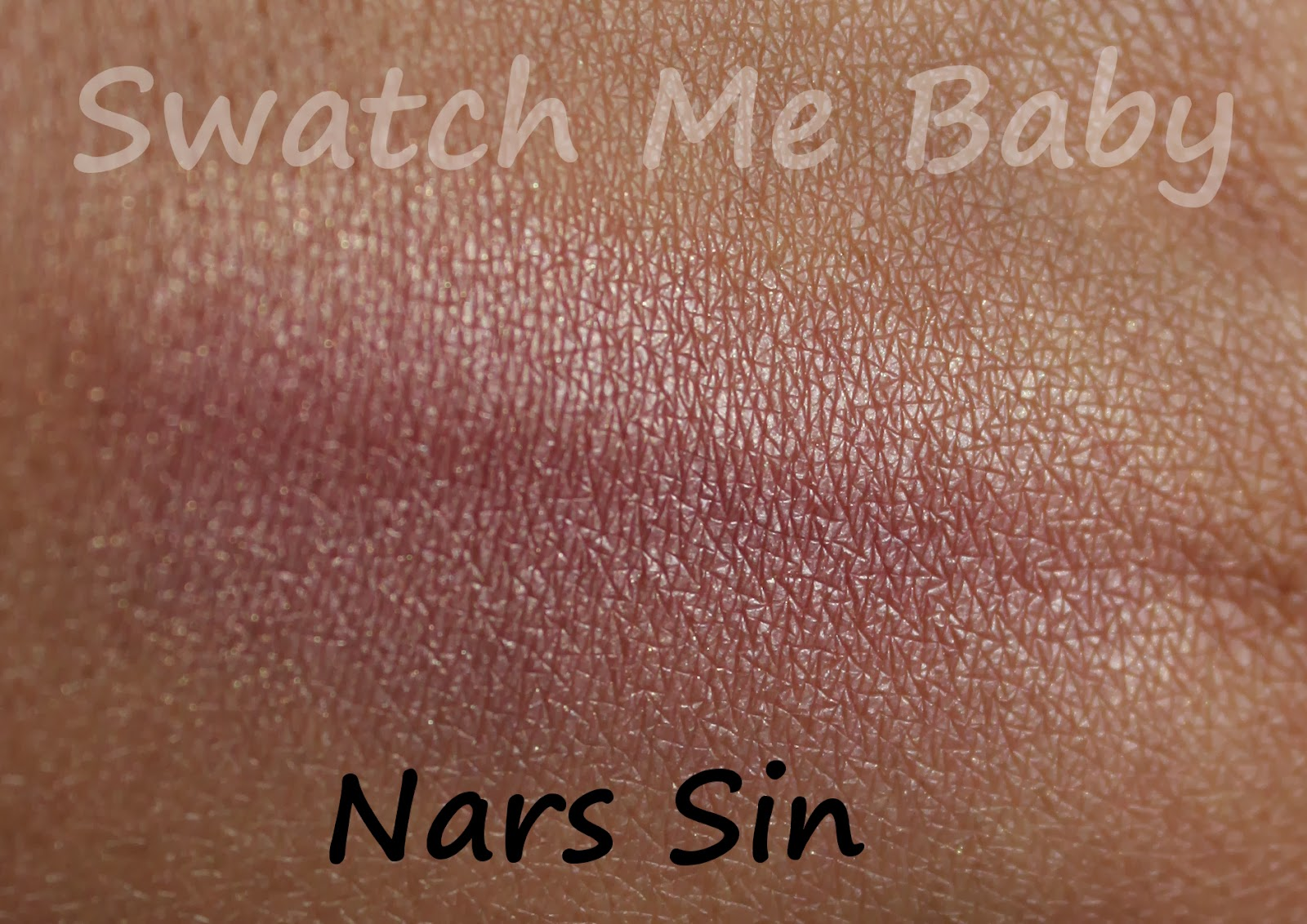 NARS Blush in Sin Swatch dark skin