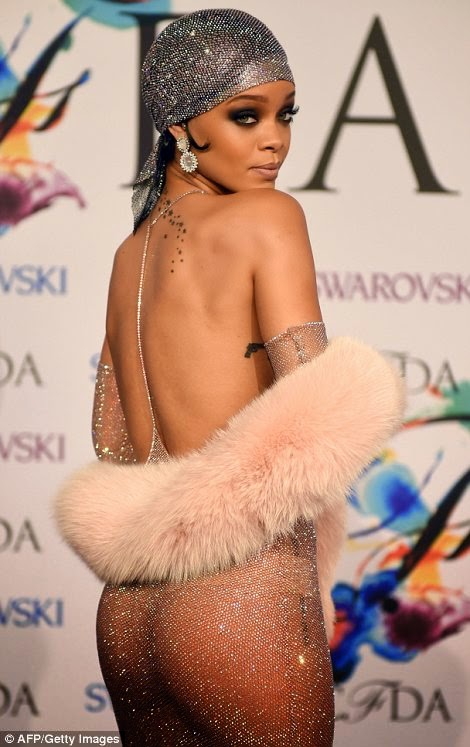 Rihanna Show off Every Inch of her Slim Figure in Racy Sheer Embellished Halter Dress