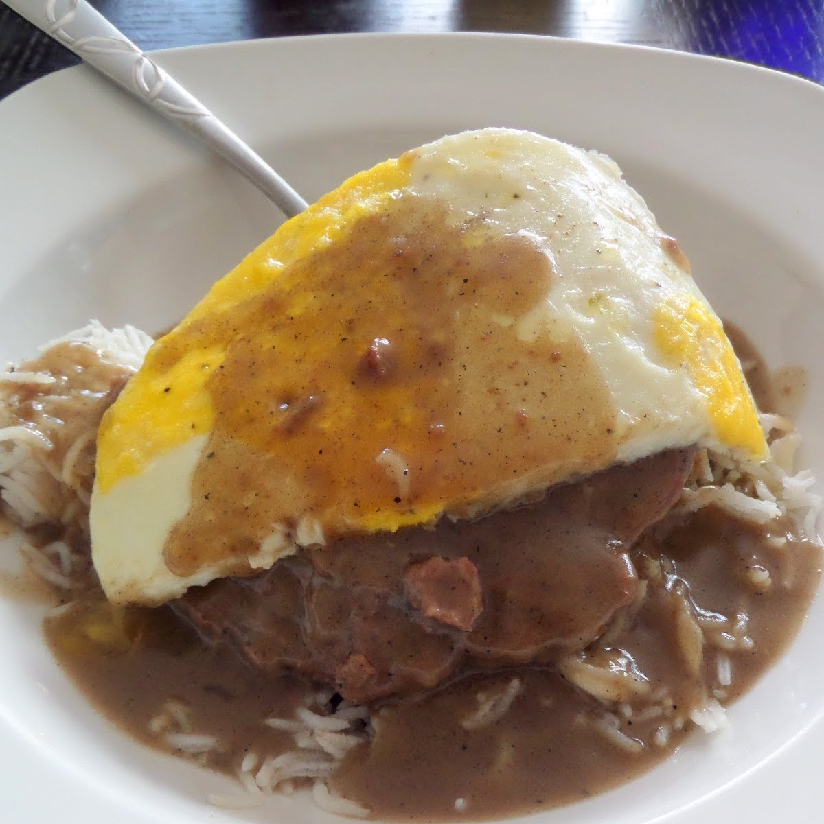 Loco Moco:  White rice smothered in brown gravy and a beef patty topped with a fried egg.  The Hawaiian breakfast of champions.