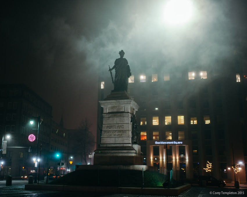 "Portland, Maine December 2015 photo by Corey Templeton. The recent low-hanging fog surrounding the city makes for some interesting photo opportunities. Here is the ""Our Lady of Victories"" statue in Monument Square last night."