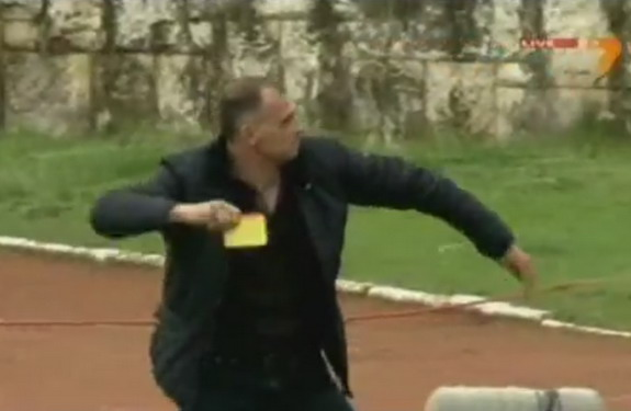 Botev Vratsa coach Antoni Zdravkov throws the cards he stole from the referee