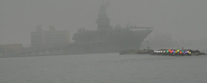 Aircraft Carrier USS Lexington thru the fog