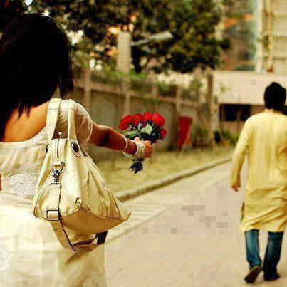 Sad And Alone Girl giving flowers to her boyfriend