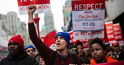 Minimum wage workers protesting