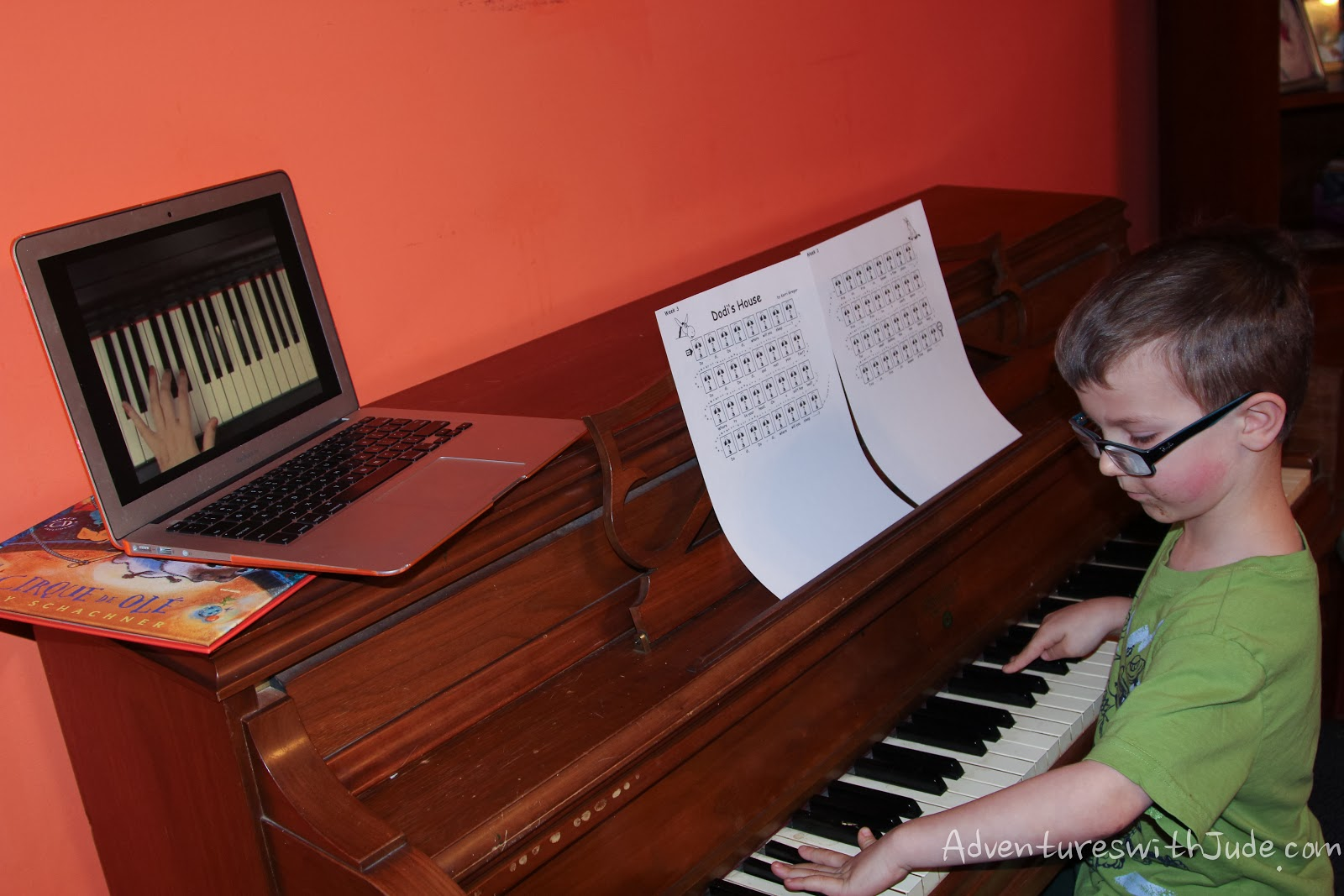 learning to play the piano that has been in the family for four generations