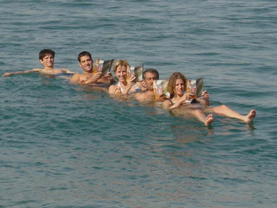 tourists floating on dead sea