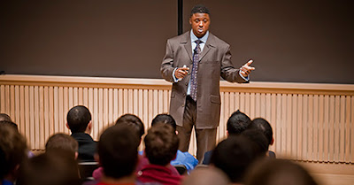 Warrick Dunn addresses students in Love Auditorium