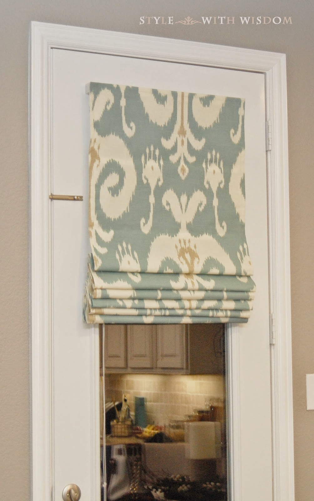 Ikat curtains door roman shade