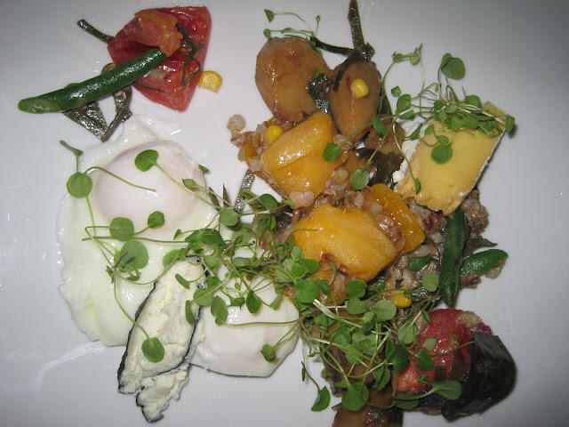 Poached Eggs with Sunchokes, Tomatoes, Wasabi Sprouts, and Cheese