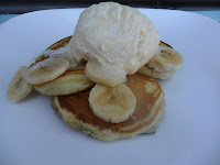Coconut pikelets with banana and ice cream.