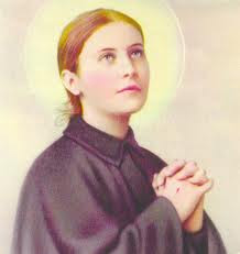 Santa Gema vestida de religiosa pasionista mirando con fervor al cielo