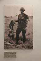 American soldier with remains of Vietnamese soldiers