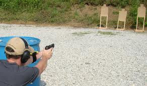 IDPA shooter engaging the last string of the classifier