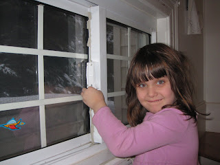 young girl adding moretight to a window