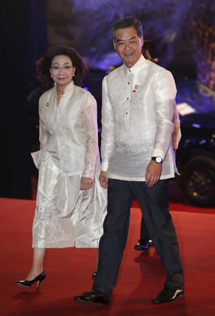 Chief Executive of Hong Kong Leung Chun-ying and his wife Regina Tong Ching-yi