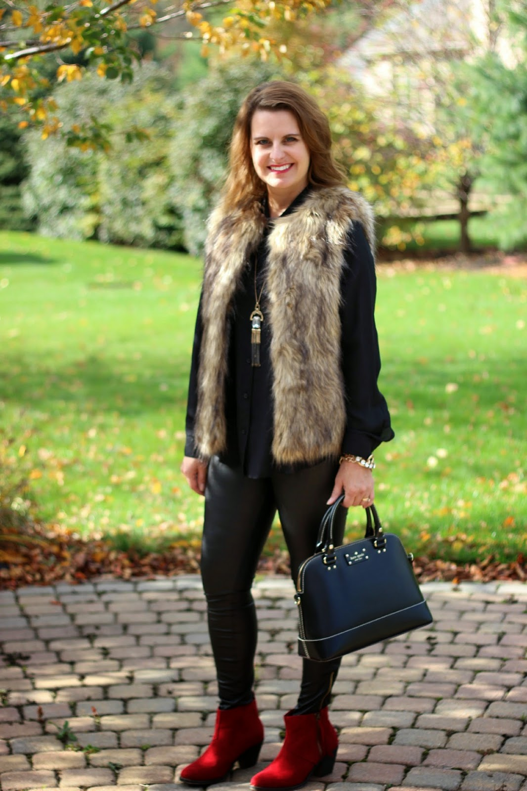 Fall outfit, faux fur vest, faux leather leggings, red booties, Kate Spade bag