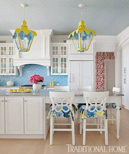 The glam pad a vibrant family lake home for Kitchen colors with white cabinets with lilly pulitzer wall art