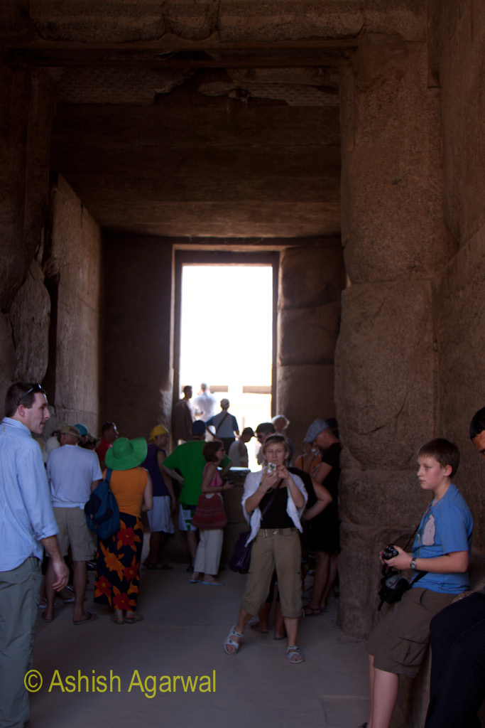 Tourists inside an enclosed section of the Karnak temple in Luxor