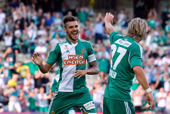 Christopher Trimmel celebrates his goal against PSG with Rapid Vienna teammate Harald Pichler