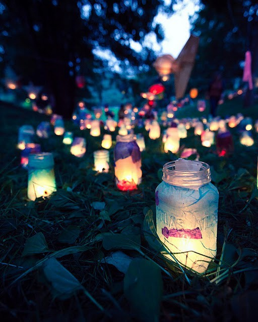 These mason jar lanterns remind me of a field of fairies