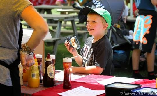 Jack Hughes, 7, Twyford, buying a hot dog - Twford School Country Fair, Twyford, Hastings photograph