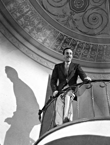Walt standing on the balcony of his staircase.