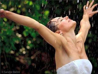 sexy girl enjoying rain fall