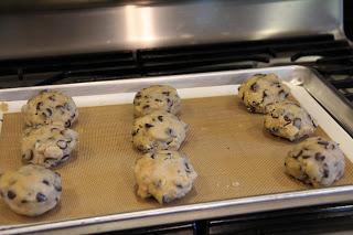 cookie dough wrapped around the oreo on baking sheet